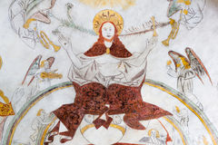 Christ sitting on the skies of heaven on judgment day. Christ sitting on the rainbow of heaven on judgment day, gothic fresco in Vinderslev church, Denmark, June stock photography
