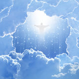 Christ in sky, easter. Jesus Christ in blue sky with white clouds and falling stars - heaven, easter stock images