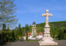 Christ statue and bell tower at orthodox Curchi monastery Royalty Free Stock Photography