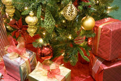 Christ tree gifts balls ornaments. Beautiful Christmas tree with shiny ornaments and gift boxes stock photography