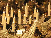 Christ under candles. Christ and detail of a Christmas tree Royalty Free Stock Image