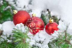 Christamas background decor ball on snow. Christamas background decor red balls on snow stock photo