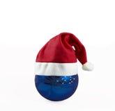 Christams ball hat. Christmas; decorations; hat; holiday; peseasonal; red; santa; season; seasonal; white; x-mas; xmas; feed; cafe; warm; commodities; natural royalty free stock images