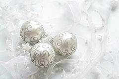 Christams baubles background. Decorative christams baubles with stars and silver ribbon, background Royalty Free Stock Images