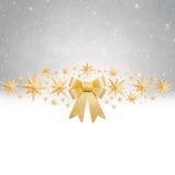 Christas背景-金黄弓和星 库存图片