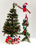 Christas characters decorating  Christmas tree, hanging star. Royalty Free Stock Photos