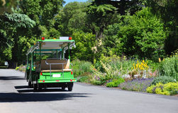 Christchurch Botanic Gardens Tour Bus. Beside the herbaceous border in full bloom Stock Photo