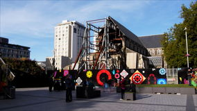 Christchurch cathedral square. Tourists visit the ruins of the church in christchurch's cathedral square three years after earthquakes devastated the city stock footage