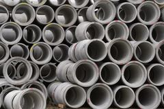 CHRISTCHURCH, NEW ZEALAND - MAY 11, 2012: Concrete round pipes stacked royalty free stock photos