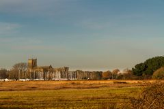 Christchurch priory from Stanpit Marsh stock photo