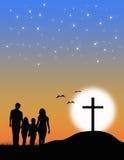 Christelijke familie bij het Kruis Stock Foto's