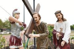 Christen en het kruis stock afbeeldingen
