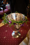 Christening bowl. Christening copper bowl in an orthodox church Royalty Free Stock Photography