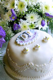 Christening cake. A christening cake in front of a flower arrangement Stock Image