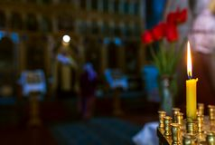 Christening in the church. Catholicism and Orthodoxy. candle on. Christening in the church. Catholicism and Orthodoxy, faith. candle on a blurred background royalty free stock images
