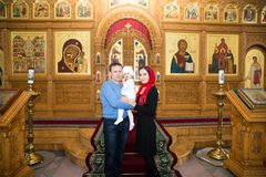 Christening. Family celebrating  baptism in Orthodox Church Royalty Free Stock Photography