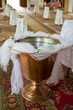 Christening font. Font decorated for christening in an orthodox church royalty free stock photography