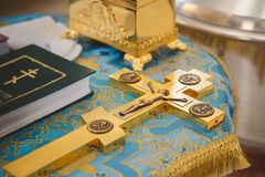 Free Christening In The Church, Golden Religious Utensils: Bible, Cross, Prayer Book, Missal. Details In The Orthodox Christian Church Royalty Free Stock Photo - 116974995