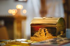 Free Christening In The Church, Golden Religious Utensils: Bible, Cross, Prayer Book, Missal. Details In The Orthodox Christian Church Royalty Free Stock Photos - 116977588
