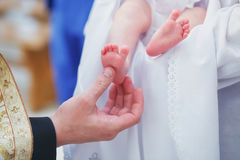Christening newborn in church. Royalty Free Stock Images
