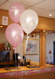 Christening party balloons Stock Photos