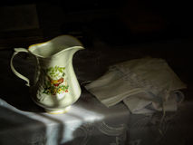 Christening set and a jug of Holy water. Royalty Free Stock Images