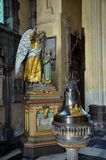 Christian angel and child statue in medieval church Stock Image