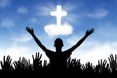 Christian Background: Worshipers. Silhouette of people worshiping to the God royalty free stock photo