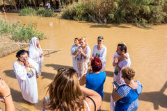 Christian baptism in Jordan river Royalty Free Stock Photos