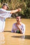 Christian baptism in Jordan river Stock Image