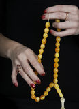 Christian believer praying. To God with rosary in hand Royalty Free Stock Images