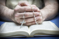 Christian believer praying to God with rosary. In hand Royalty Free Stock Image