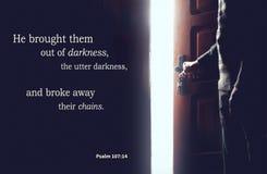 Christian bible verses psalm 107: 14, elderly senior in darkness and light from an open door