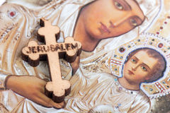 Christian blessed wooden cross and holy mother in background.  stock photos