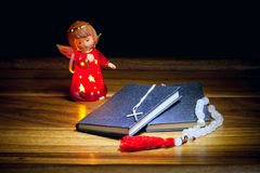 Christian books with a cross, beads and a figure of an angel Royalty Free Stock Photo