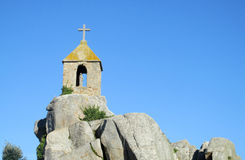 A christian chapel on coast rocks in Ploumanach Stock Photos
