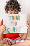 Christian child thanking God. Boy praying,praising and thanking God. Religious kid over a white background. Young Hispanic child praying.He is thanking God and Royalty Free Stock Photo