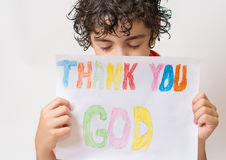 Christian child thanking God. Boy praying,praising and thanking God. Religious kid over a white background. Young Hispanic child praying.He is thanking God and Royalty Free Stock Photography