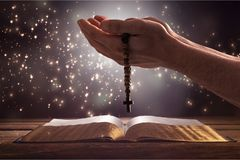 Christian. Cross jesus pray rosary abstract concept Stock Images