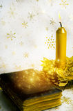 Christian Christmas. Christian bible with gold candle and christmas background Stock Photography