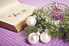 Christian Christmas. Bible with a Christian cross with Christmas decoration Royalty Free Stock Image