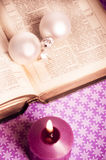 Christian Christmas. Open bibble with Christmas decorative balls and candle stock images