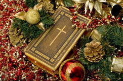 Christian Christmas. Selective focus on Bible surrounded by Christmas ornaments Royalty Free Stock Photos
