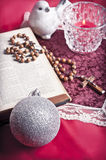Christian christmas. Christmas still-life background with x-mas decorations, a bible and a Christian cross Stock Photos