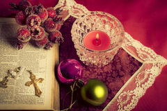 Christian christmas. Christmas still-life background with x-mas decorations, a bible and a Christian cross Royalty Free Stock Image