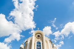 Christian church against the blue sky with clouds background. Background.  Stock Images