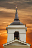 Christian church bell tower. On a background of purple sunset stock photography