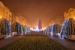 Christian Church at Christmas time - 01. Christmas decorations in the night and Orthodox Church in the far background Stock Image