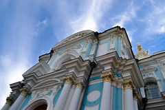 Christian Church with a cross on blue sky background. On the photo: the Church of Resurrection (Smolny Cathedral), located in St. Petersburg. Christian Shrine Royalty Free Stock Photos