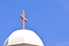 Christian church dome and cross. Dome and red cross of Christian church architecture under blue sky in Asia, shown as featured element of building and religious Stock Photo